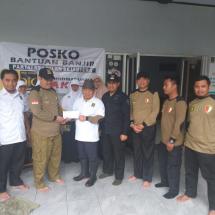 Jazuli Juwaini Kembali Serahkan Gaji DPR untuk Korban Banjir Banten